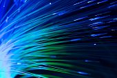 stock photo of optical  - bunch of optical fibres flying from deep as blurred abstract technology background - JPG