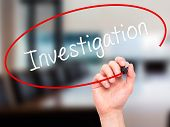 image of investigation  - Man Hand writing Investigation with marker on transparent wipe board - JPG