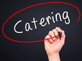 pic of catering  - Man Hand writing Catering with marker on transparent wipe board - JPG