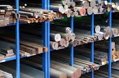 picture of racks  - Racks of steel and iron bars to be used in the engineering and manufacturing process in a workshop to produce industrial components - JPG