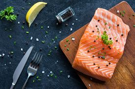 pic of sea fish  - Raw salmon fillet on a wooden cutting board  - JPG