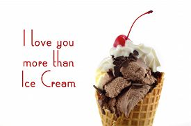 stock photo of vanilla  - Chocolate and vanilla ice cream wafer cone with whipped cream and cherry with stem on top with I Love You More Than Ice Cream quote - JPG