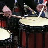 Scottish bandsman beats the drum