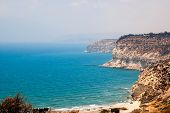 Kourion Coast With Blue Sea And Sky With Clouds