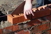 Close up of bricklayer at work