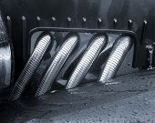 Close up of section of car hood showing manifold pipes