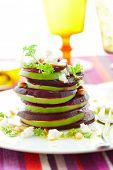 Tower of beetroot,goat's cheese and avocado with pine nut