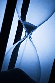 detail of hourglass on blue