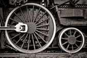 steam locomotive wheel detail in warm black and white