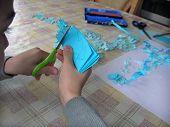 Little Boy Cutting A Paper