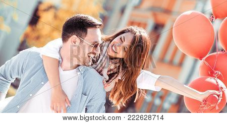 poster of Happy Young Couple Sitting On A Bench Together.