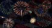 image of usa flag  - Fireworks Over a US Flag on the 4th of July - JPG