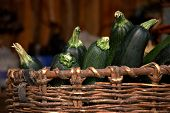 Close Up Of Green Vegetable Marrows In A Basket