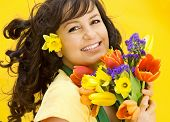 beautiful girl with spring-flowers