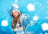 stock photo of snowball-fight  - pretty girl throwing a snowball - JPG