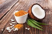 Shredded Coconut, Coconut Flakes And Coconut Powder In White Bowl On Wooden Table. Healthy Coconut P poster