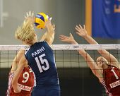 DEBRECEN, HUNGARY - JULY 8: Rita Liliom (in red 1) in action at a CEV European League woman's volleyball game Hungary (Red) vs Israel (Blue) on July 8, 2011 in Debrecen, Hungary.