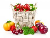 Berry in wicker basket still life with fruits and green leaves, isolated on white background. poster