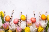 Colorful tulips with branches pussy willows and easter eggs on old background. Festive  Easter conce poster