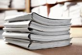 Stack of cardboard folders with documents in archive, closeup poster