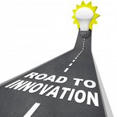 The words Road to Innovation on a pavement road leading upward to a light bulb representing imaginat