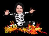 Adorable Little Boy Dressed In Skeleton Costume. Isolated
