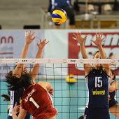 DEBRECEN, HUNGARY - JULY 8: Rita Liliom (in red) in action at a CEV European League woman's volleyball game Hungary (Red) vs Israel (Blue) on July 8, 2011 in Debrecen, Hungary.
