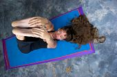 Woman On Yoga Mat Stretching Hamstrings