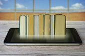 Ebook Concept. Some Books With Ebook Reader Or Tablet Pc On A Wooden Table. poster