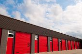 Storage Building With Red  Numberd Doors