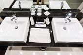Black And White Sink With Mirror In A Luxury Granite Bathroom Interior. Apartment Or Hotel Bathroom poster