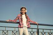 Girl Child Listen Music Outdoors With Modern Headphones. Enjoy Music Everywhere. Best Music Apps Tha poster