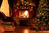 Christmas living room interior with decorated fireplace, armchair and xmas tree poster