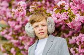 Boy Fashionable Teen Posing Near Sakura. Confident Stylish Child Enjoy Warm Spring Day. Sakura Garde poster