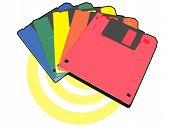 Multicolored Diskettes On Yelow Ring And White Background