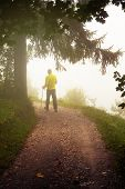 Young Male Hiker With Walking Poles Walking Away On A Dirt Path On A Misty Morning. Nordic Walking,  poster