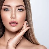 Beauty face of the young beautiful woman  with a fresh healthy skin. Closeup portrait of an attracti poster