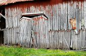 stock photo of sag  - Collapsing and sagging double barn doors barely hang on to their hinges - JPG