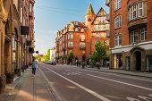 Street Life In Copenhagen. People Walking, Riding Bikes In The City Center. poster