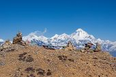 Buddhist Prayer Flags On Cairns In Himalayas With Mt. Dhaulagiri In Background. Version 2. poster