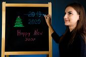Inscription Happy New Year On Black Board. Black Board With Hand Inscription Happy New Year With Cha poster
