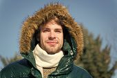 Man Unshaven Wear Warm Jacket With Fur Snowy Nature Background. Guy Wear Winter Jacket With Furry Ho poster
