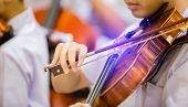 Asian Boy Students Playing Violin With Music Notation In The Group. Violin Player. Violinist Hands P poster
