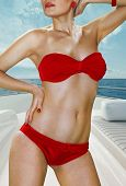 picture of concubine  - blonde woman in red underwear on deck of yacht - JPG