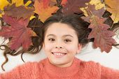 Leaves In Her Hair. Amazing Autumn. Little Child Maple Leaves In Hairstyle. Small Girl Smile Autumn  poster