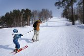 Professional Ski Instructor Is Teaching A Child To Ski. Family And Children Active Vacation. Sunny D poster