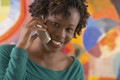 Young African woman on cell phone
