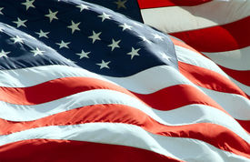 foto of waving american flag  - Close up view of American Flag waving in the wind - JPG
