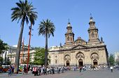 SANTIAGO - FEBRUARY 1, 2012: Summer brings tourists to downtown Santiago. Visitors gather in front o