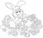 foto of cony  - Rabbit painting Easter eggs to the upcoming holiday - JPG